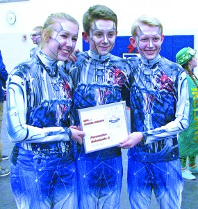 DC Drumline students Kylie Johnson, Haydn Veith, and Ryan Johnson celebrated their first-pace finish following the March 17 competition.