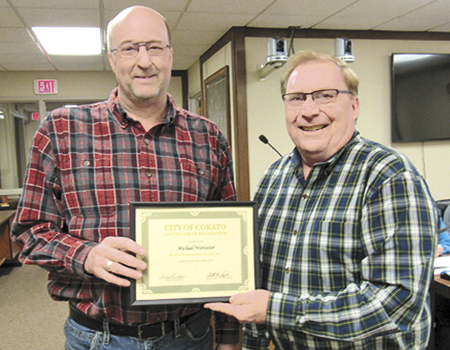 Cokato Museum Director Mike Worcester (left, pictured with Cokato Mayor Gordy Erickson) was recognized for his 25 years of service to the Cokato community April 9.