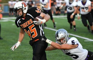 Delano's passing game has been good through three games, and a number of different receivers have been involved. Here, fullback Chris Glunz picks up some yards after the catch last week against Glencoe-Silver Lake. Photo by Matt Kane