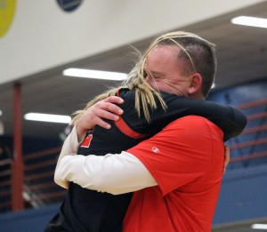 Senior Madi Beck shares a hug with her father Jason Beck are getting her Section 2A championship medal. Jason is an assistant coach for the Crusaders this season.