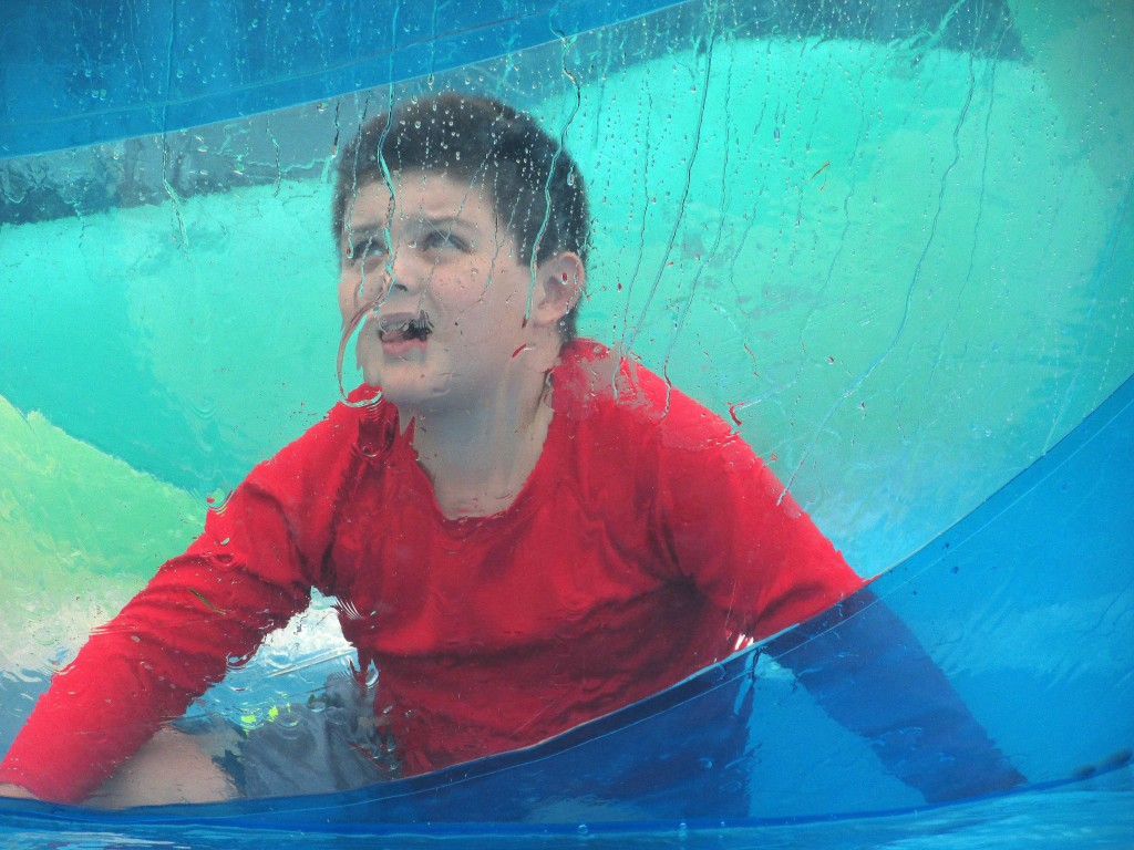 Despite the challenge, young Ben had fun learning it is actually difficult to walk on water at the water ball pool at the McLeod County Fair.