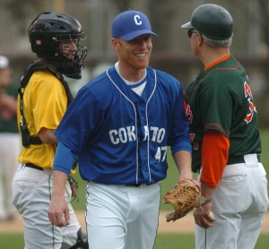     Cokato Kings pitcher Eric Pokornowski smiles as he is removed from the game by NSL All-Stars Manager Steve Eilen May 11 in Delano. Pokornowski gave up three home runs and five runs to the St. Paul Saints. He failed to get an out.