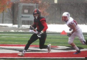 Senior Branden Carlson makes his way upfield after intercepting pass in the second quarter of the Section 4A title game.