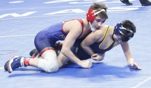 Austin Gabbert come out firing in his first match of the Class AA state tournament. He took down Totino-Grace's Micael Loger with a first-period pin just 39 seconds into the match.