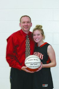 Kris Gustin has been the coach for his daughter Emilee since fifth grade. Emile scored her 1,000th career point Thursday, Feb. 9, becoming just  third girl in school history to reach that milestone.