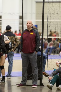 University of Minnesota volleyball head coach Hugh McCutheon looks on as Olivia Tjernagel plays a match with her High Voltage Club.