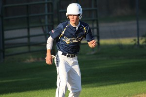 Howard Lake's Alex Baumann gets a nice jump to the plate while on third base.