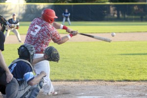 Jared Duske lines a base hit for the Watertown Red Devils in their 16-3 victory in seven innings over Winsted July 10. Duske and the Red Devils continue to stay hot as they remain atop the CRVL North division with an 11-2 record.