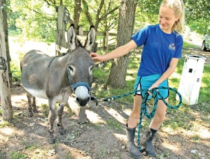 Josie Dolezal with Bucky the donkey