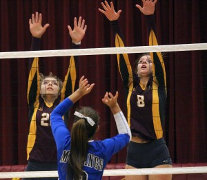LP/HT's Kayla Weinzierl and Rileigh Shackelton rise to block an attack in LP/HT's 3-1 loss to BLHS Tuesday night.