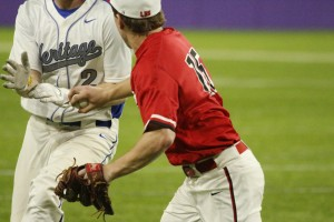 Mayer Lutheran's Matthew Menth tags the Heritage Christian baserunner for the dramatic final out.