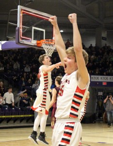 Mayer Lutheran senior Cole Hagen is pumped up after sending the Crusaders to the state tournament with a 3-pointer at the buzzer to beat Springfield 78-75.