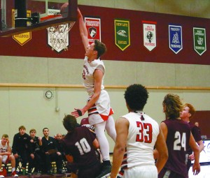 Baden Noennig soars up for a monster dunk for the Crusaders in their thrilling 71-70 victory against SW Christian to kick off 2018. After a rough first half, Noennig took out some frustration with his dunk while also pumping up his teammates.