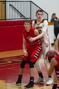 Mayer Lutheran senior Garrett Tjernagel had his hands full all game long dealing with Jordan's Eric Tiedman and Andrew Niebuhr inside the paint.