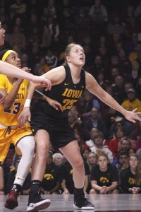 Monika Czinano battles for rebounding position in Iowa's matchup with the Minnesota Gophers Monday night. It was Czinano's first trip back home with the Iowa Hawkeyes.