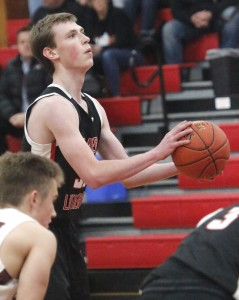Mayer Lutheran senior Riley Krueger attempts a free throw in his first game back since beating cancer.