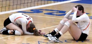 Delano's Amy Lundquist (3) and Grace Popp hit the floor in tears just after the ball hit the floor to end the Tigers' season Thursday at the Section 5AA final against Watertown-Mayer. Photo by Matt Kane
