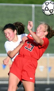 Delano's Eva Rousu tries to get her head to the ball ahead of Mound-Westonka's Avery Jenson during Tuesday's Section 6A game. Delano won the game 1-0, and will play at Heritage Christian Academy Thursday. Photo by Matt Kane
