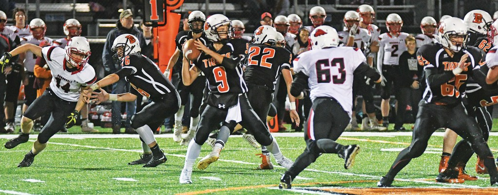 Delano quarterback Mike Shoultz receives the protection he needs on this pass play in the first quarter against Annandale Oct. 6 at Tiger Stadium. Shoultz threw for two touchdowns and ran for another in the 34-20 win. The senior will attempt to burn the Dragons of Litchfield with his arm this Friday night. Photo by Matt Kane