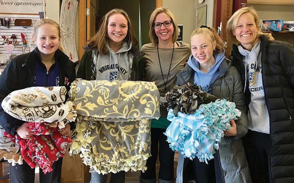 Players who delivered the blankets (below photo) are Ava Reierson, Lauren Brouwer, Madeline Engel and Manager Britta Reierson.
