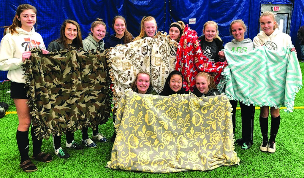 Pictured in the team photo are (front row, from left) Lauren Brouwer, Gracie Larson and Madeline Engel; and back row:  Ava Chappuis, Victoria Viteri, Maggie Leipholtz, Sydney Kazin, Kendra Ellis, Maddy Remer, Ava Reierson, Livia Loecken and Amber Peterson. Not pictured are McKenna Allen, Hattie Jackson, Lucy Paul, Grace Panek, Kelly Peterson, Lucy Smith and Emma Wolf. Photo submitted