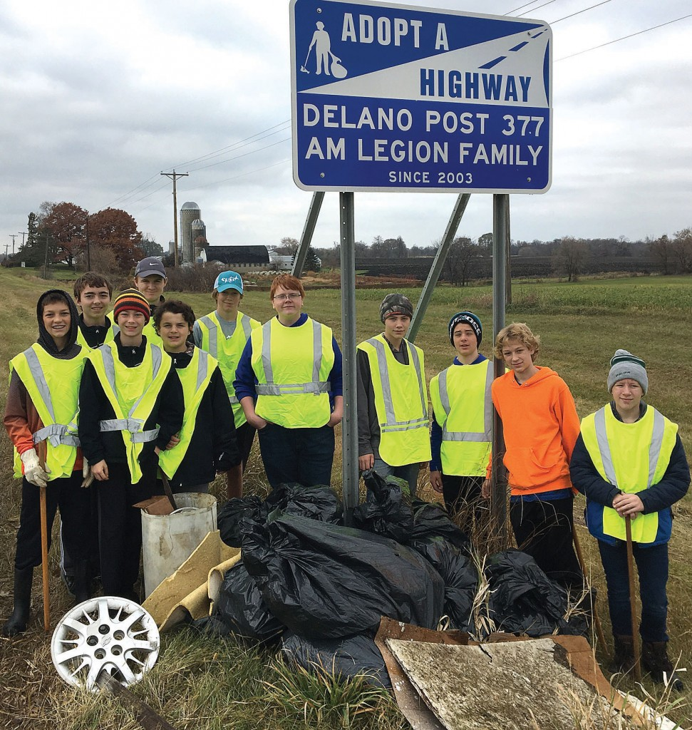 The Delano Bantam C hockey team recently helped out the Delano American Legion by lending a hand cleaning its adopted section of Highway 12 as a team service project.