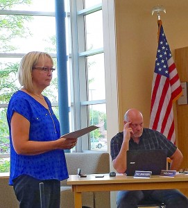At Monday's Howard Lake-Waverly-Winsted School Board meeting, financial consultant Donna Wilson gave a report on potential property levy numbers payable in 2018. She is pictured with Board Member Paul Bravinder.