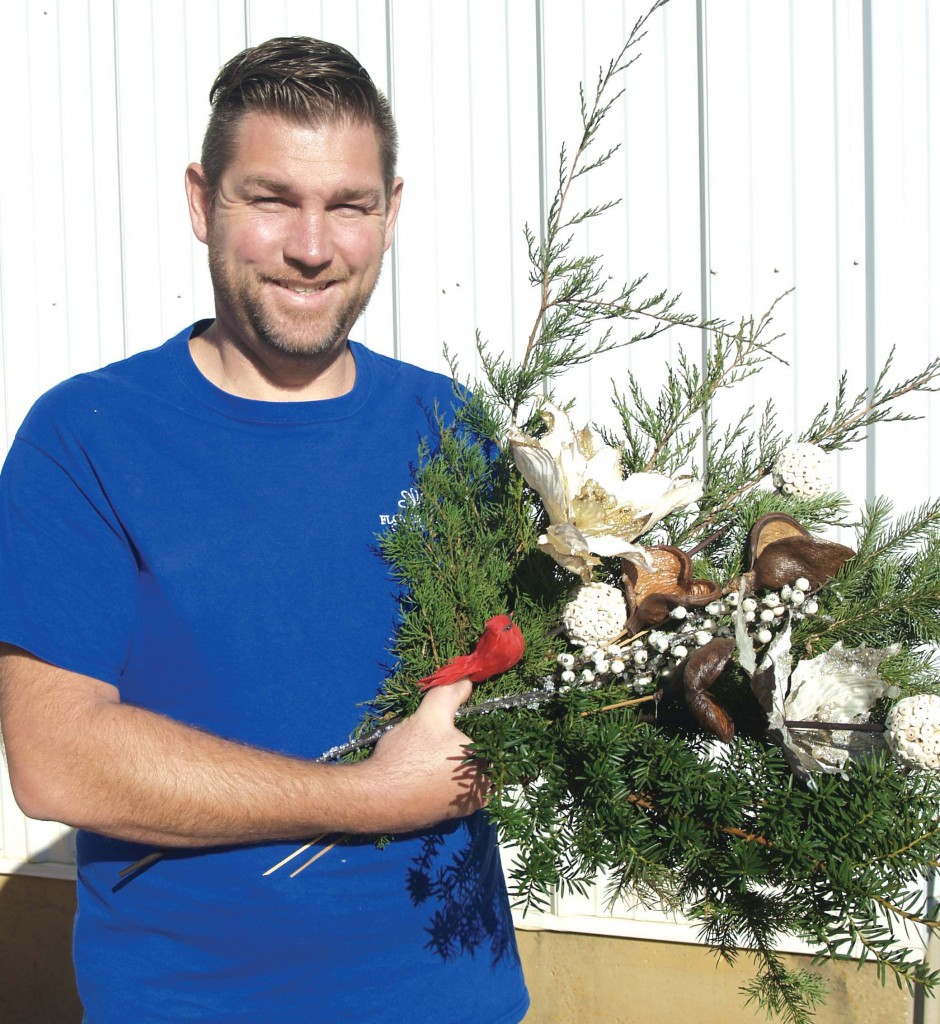 Retail Manager Jason Ziermann shows some holiday greenery.