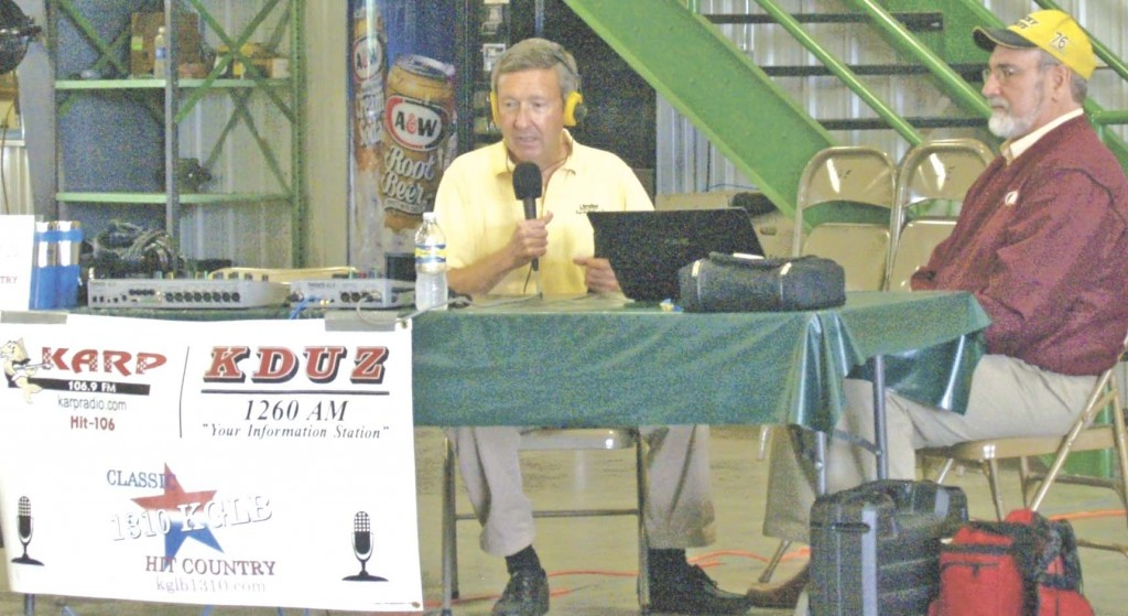 "Photo by Starrla Cray Lynn Ketelsen of the Linder Farm Network broadcast the Mid-Day Farm Review at Midwest Machinery in Glencoe July 16, as part of KGLB radio's Glencoe Farm & Ag Day. Above, Ketelsen gets ready to analyze the market with Marc ""Pete"" Peterson, director of United Farmers Coop's risk management department."