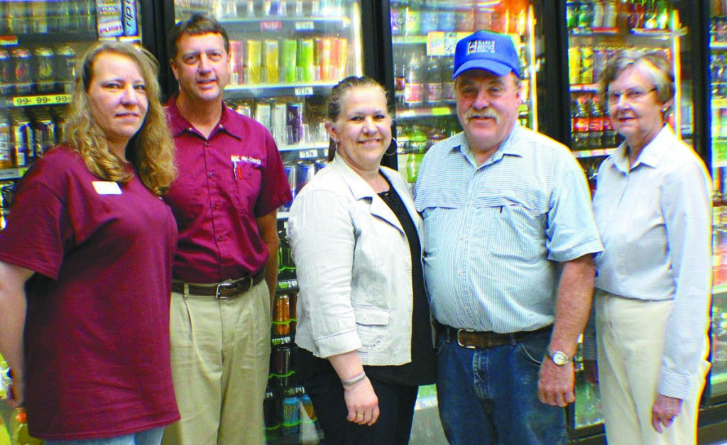 Mark Karels recently sold Mark's Service in Waverly to Mid-County Coop. Pictured are: store manager Missie Beckmann, Mid-County Coop General Manager Bill Reimers, Giny Karels, Mark Karels, and Waverly Mayor Connie Holmes.