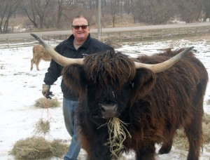 Myron Boll with his Scottish Highland cattle