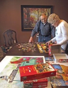 Garden House residents Ed and Irene Fasching enjoy doing jigsaw puzzles together. Previously, the couple had a farm about three miles southwest of Winsted. They're still able to spend time outdoors, whether it's taking walks on the heated sidewalks in the winter or weeding the garden in the summer.