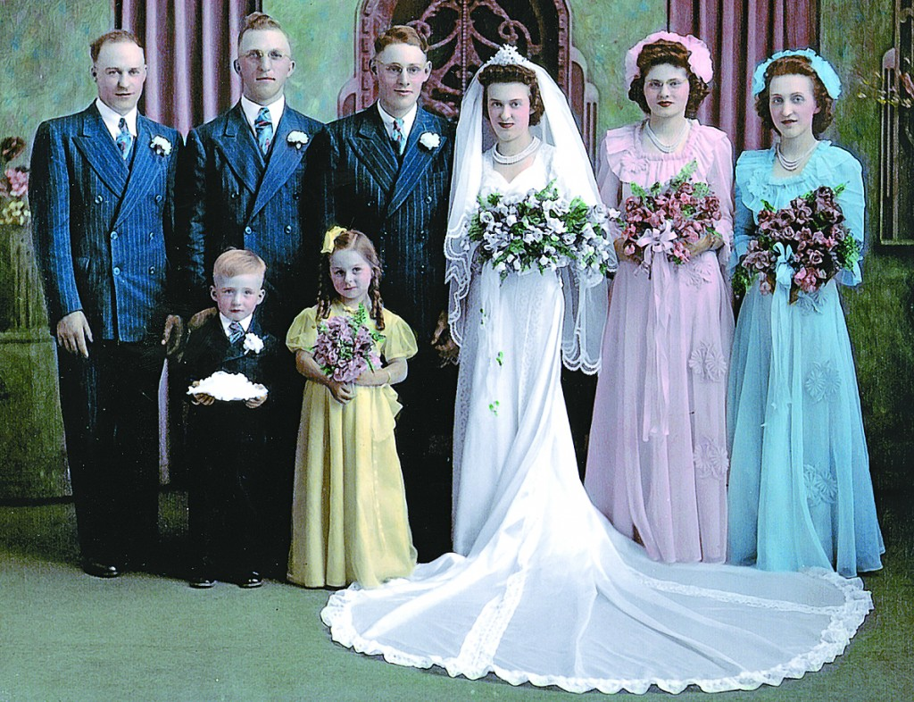 Marvin and Ellen Scheuble's wedding day was June 6, 1944 at St. Mary's Catholic Church in Waverly. Adults pictured are Ervin Cardinal, Joe Kuka, Marvin Scheuble, Ellen Babatz, Dorothy Scheuble, and Florence Cardinal. The ring bearer is Bob Pollock, and the flower girl is Mavis Vossen.