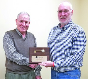 Retiring Winsted City Council Member George Schulenberg was presented with a plaque by Mayor Steve Stotko at Tuesday's council meeting.