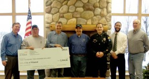 Siren contributors gather in Winsted Representatives from businesses and organizations that donated money toward a new civil defense siren near the Winstock festival grounds met at Winsted City Hall Tuesday morning. Pictured are Tod Norgren of CenterPoint Energy, Gerald Kucera of DuPont Pioneer, Winstock committee member Ron Otto, Clem Crowley of Centra Sota, Winsted Police Chief Justin Heldt, Winsted City Administrator Clay Wilfahrt, and Winsted Mayor Steve Stotko. The total cost of the new siren was just over $19,000. Donation amounts were $2,500 from CenterPoint Energy, $2,500 from DuPont Pioneer, $1,500 from Centra Sota, and $5,000 from the Winstock committee. As of Tuesday evening, Winsted Police Chief Justin Heldt said the siren has not been delivered yet, but he anticipates installation in early spring.